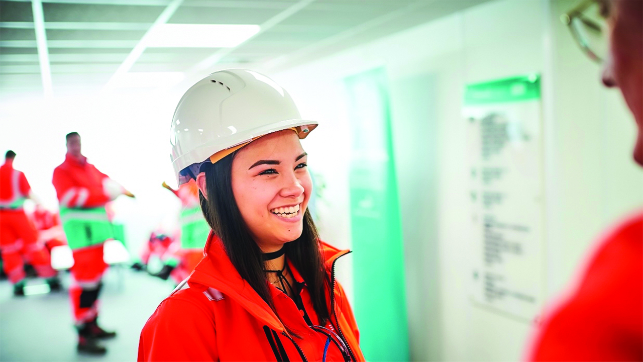 Female apprentice wearing high vis clothing