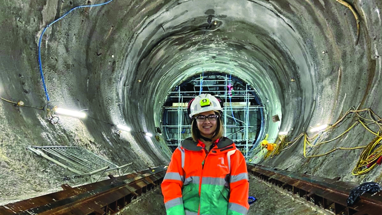 Female apprentice at Costain standing in tunnell